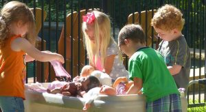 Kids learn how to take care of other people with doll toys